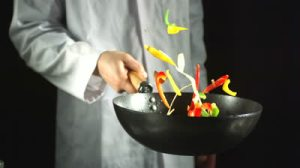 stock-footage-chef-tossing-vegetable-stir-fry-in-a-wok-in-slow-motion